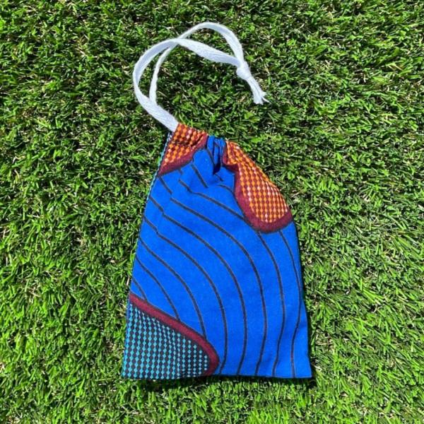 Washable make up remover pads in royal blue pocket...
